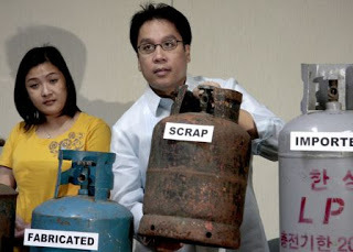 20090811230810700_Mar Roxas warns of defective LPG tanks.jpg